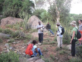 Station staff discuss an abandoned habitation site